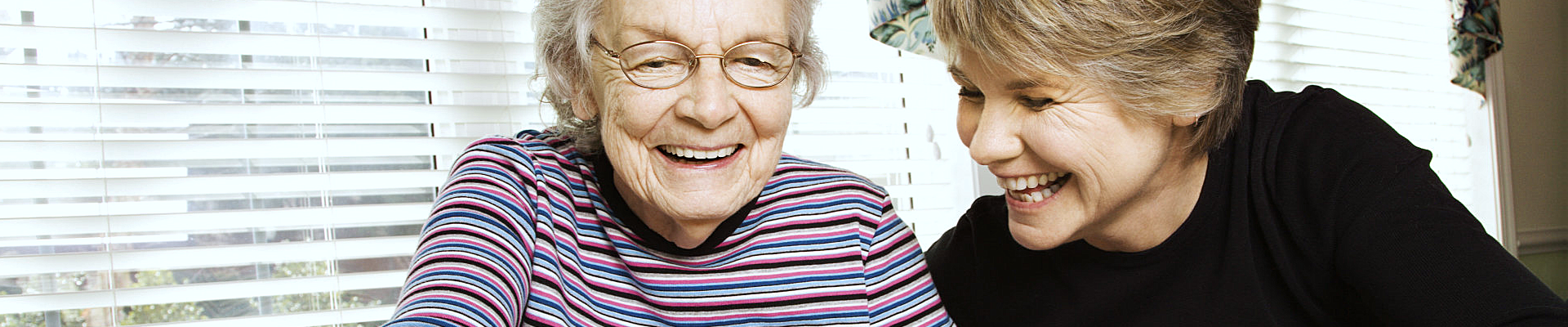 caregiver and patient laughing at something